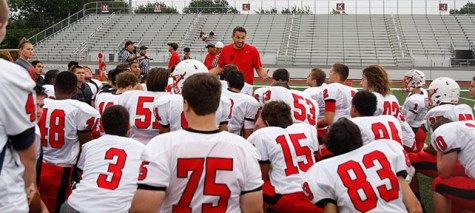 Varsity football coach Ben Bartlett talks to football team prior to a scrimmage held on August 28th.