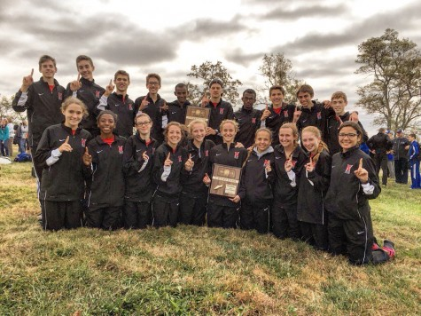 Girls and Boys Cross Country Team after winning the 6A regional meet.