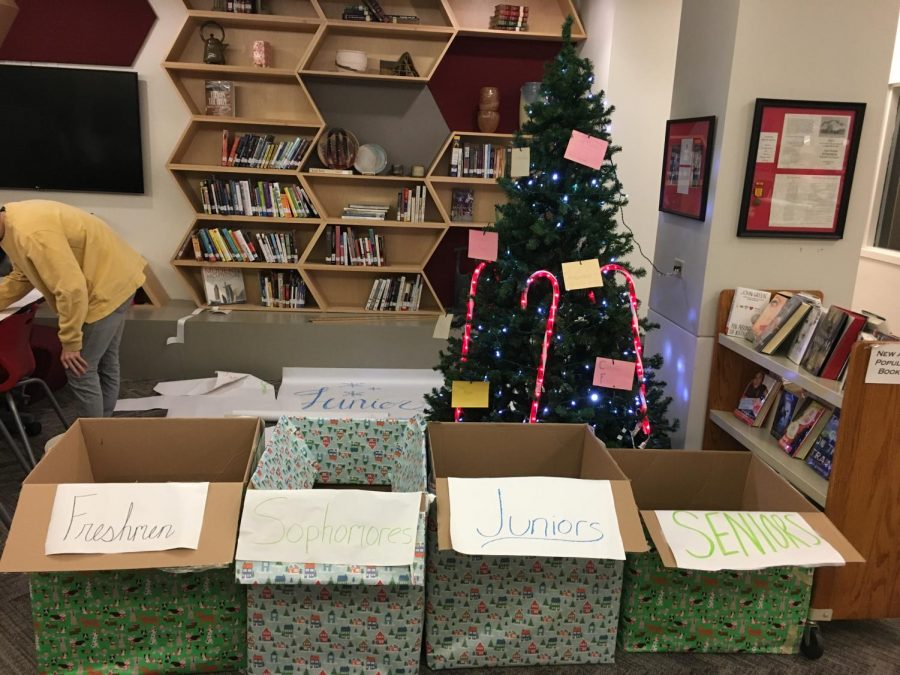 Tags placed on a Christmas tree in the learning commons show the kind of items needed for the Holiday Drive.