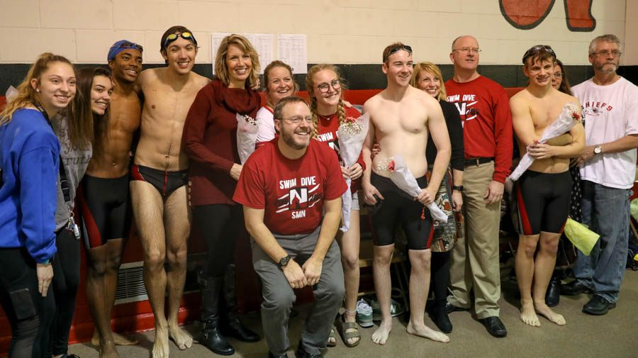 Coach Fothergill with senior swimmers and parents.