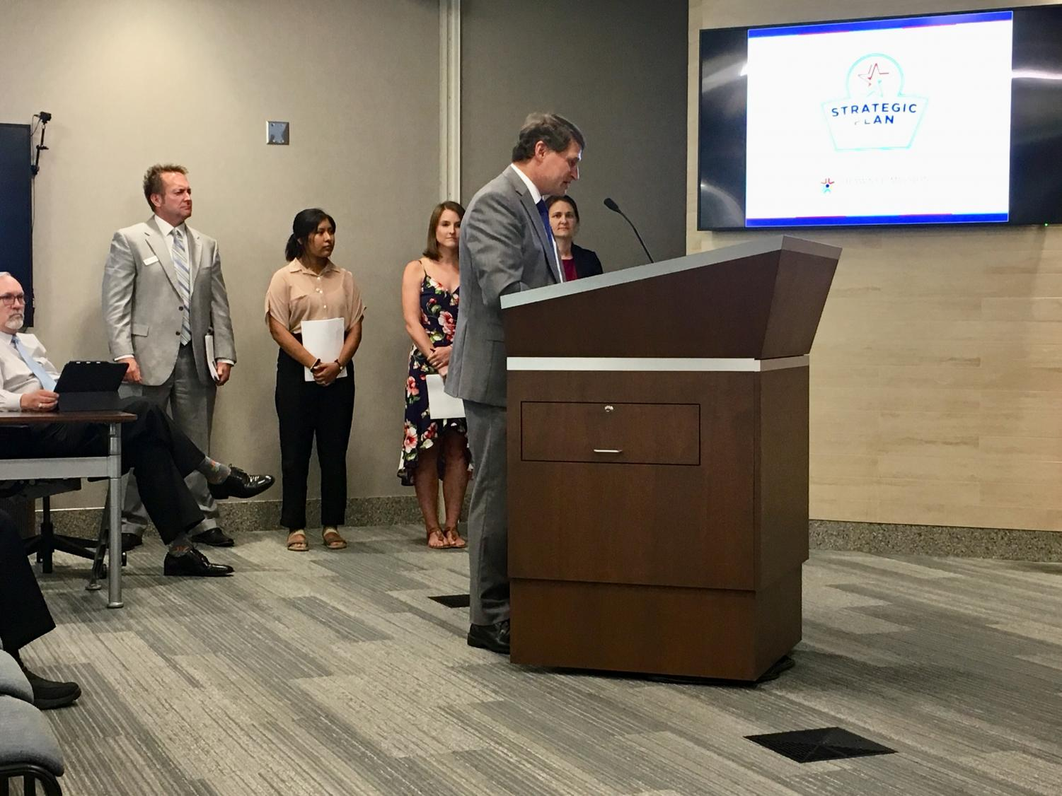 Superintendent Michael Fulton unveils the district's new strategic plan with the help of parent, teacher and student representatives from the steering committee.