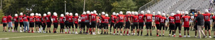 SMN football players stand in a line at the end of the game instead of shaking hands with opposing team.