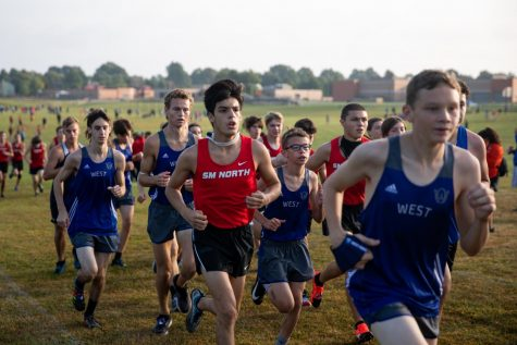 Senior Jacob Slobodzian runs with the pack at the Midseason Hootenanny. Slobodzian placed 53 in the JV race. Evan Whitaker