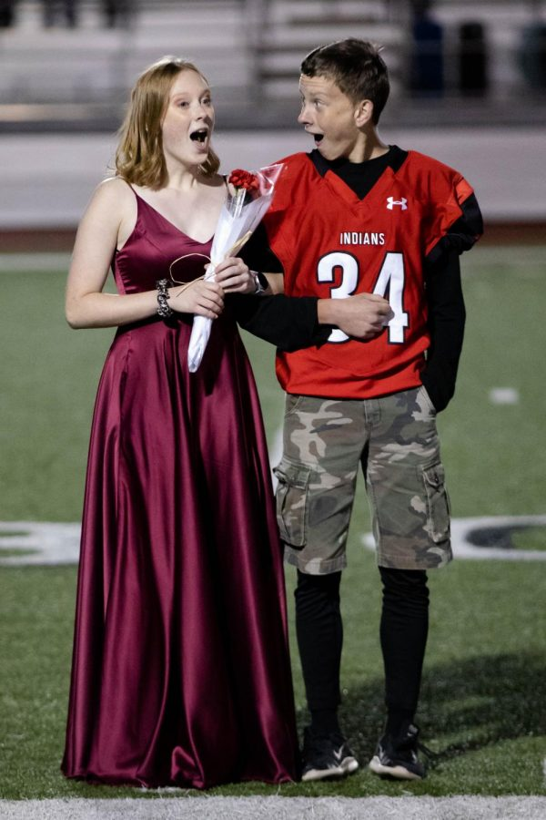 Moments after being announced Homecoming Queen, senior Ruth Long reacts with her brother sophomore Josiah Long. Josiah escorted his sister.