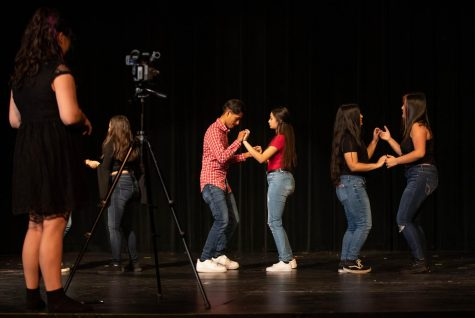 "Josie Lenati films one of step dance practice routines after school. ""Everyone is just so on top of it, it's very rare that I take more than two takes,"" Lenati said. ""Having the B-roll where I can get different angles while the main camera is rolling, is really cool as well."""