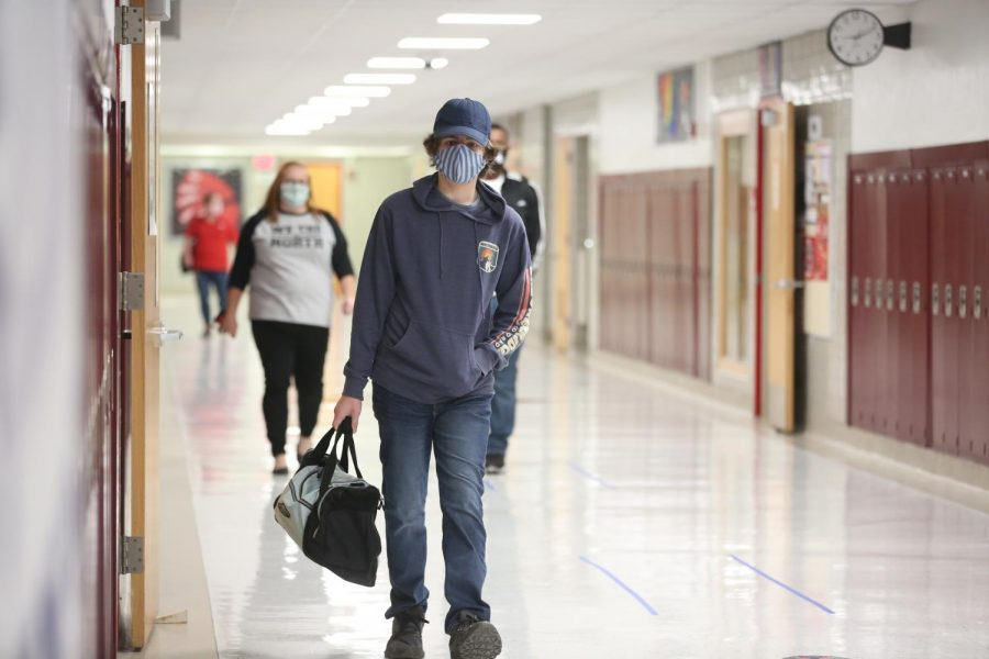 Junior Cole McNickle walks to one of his classes. To reduce transmission rates and overall population, student's in-person schedules were split into in-person and remote days. Those days are A and B days, on Friday all student are remote.