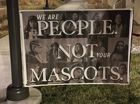 "A sign hung at the Center for Academic Achievement during the Jan. 25 meeting reads: ""We are people not your mascots""."