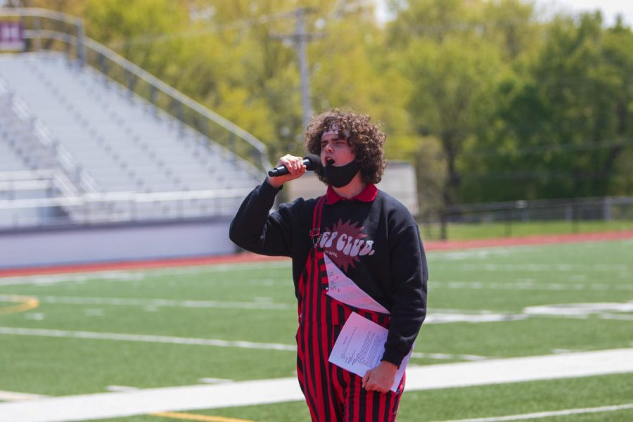 Senior Luke Cramer hyping up the crowd during a chanting competition.